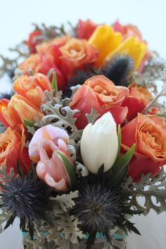 Centerpieces of coral, pink and gray. Roses, tulips and thistle in a rustic wood box. // www.jormondevents.com