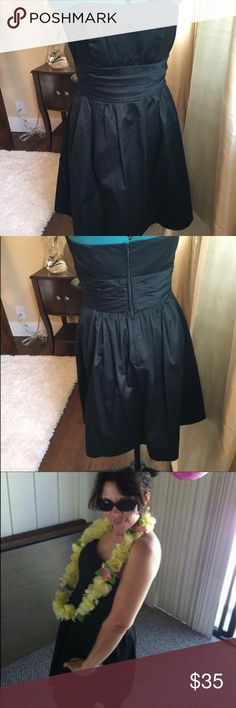 """☔️SALE☔️Black strapless dress. Great shape! Cute, comfortable strapless party dress with pockets!!' Can keep simple with flats and bangles, or dress up with heels and a statement necklace.  Size 6, 29"""" length.  Zips up back.  Worn twice. David's Bridal Dresses Strapless"""