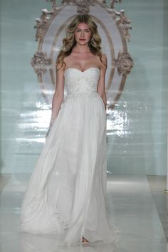 Nothing says va-va-voom more than with a sweetheart Reem Acra wedding gown. (Photo: Dan Lecca)