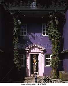 Surrealist sculpture beside front door of purple house formerly owned by surrealist Edward James - Stock Image