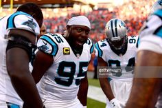 Defensive end Charles Johnson #95 of the Carolina Panthers pumps up his teammates before taking on the Denver Broncos at Sports Authority Field at Mile High on September 8, 2016 in Denver, Colorado.