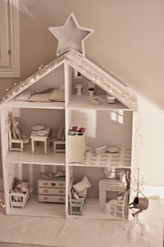 House shaped shelving makes an ideal dolls house