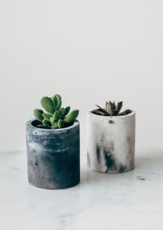Designed and made by Little Deer in Brighton, UK, these cylinder concrete planters come in a beautiful marbled effect.    Please be aware that we hand make each pot and therefore every pot will be slightly different. Each as beautiful as the one before! Pot comes with the addition of a 'Plant your own Succulent' bag which includes soil and a plant.