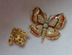 Kenneth Jay Lane butterfly brooch and  Joan Rivers bee pin