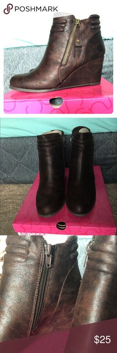 Brown Wedge Booties Brand New. Never worn. Never taken out of box except for pictures. Faux zipper on the outside of shoe, real zipper in the inner side of the shoe. Great for any outfit casual or dressy! Sugar Shoes Ankle Boots & Booties