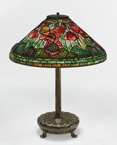 "Tiffany Studios | ""POPPY"" TABLE LAMP shade impressed TIFFANY STUDIOS NEW YORK 1531-3 base impressed TIFFANY STUDIOS/NEW YORK/359/S173 leaded glass and patinated bronze 25 3/4  in. (65.4 cm) high 20 1/4  in. (51.4 cm) diameter of shade  circa 1905 