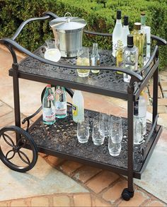 Our Orleans Serving Cart makes it beautifully easy to enjoy tableside service while you dine or imbibe. Merely push to bring beverages and foods to guests. Cast in strong aluminum, the cart features two tiers with smooth lattice-embossed surfaces, wide handle, and rich chocolate finish. Two rubber-tipped wheels and a pair of casters enable the cart to smoothly glide over any surface.