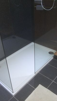 Low profile shower tray and glass panels supplied by Lakes Bathrooms
