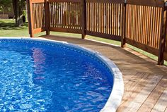 With the money you save by getting an above ground pool, you can install a wraparound deck that improves its looks and functionality. Some above ground pools with decks are even difficult to distinguish from inground pools. Above Ground Pool Prices, Cleaning Above Ground Pool, Above Ground Pool Heater, Above Ground Pool Lights, Installing Above Ground Pool, Above Ground Pool Decks, Above Ground Swimming Pools, In Ground Pools, Oberirdischer Pool