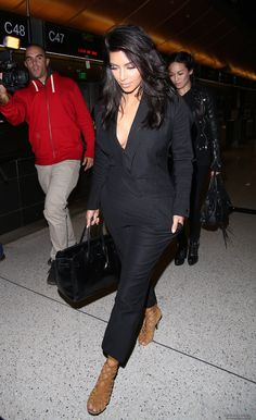 Kim departing on a flight at Los Angeles International Airport in Los Angeles