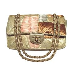 Chanel Shimmery Leather & Raffia Classic Flap Shoulder Bag. Get one of the hottest styles of the season! The Chanel Shimmery Leather & Raffia Classic Flap Shoulder Bag is a top 10 member favorite on Tradesy. Save on yours before they're sold out!