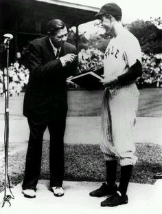 Babe Ruth donating his autobiography to the captain of Yale baseball team & future president George H.W. Bush, 1948