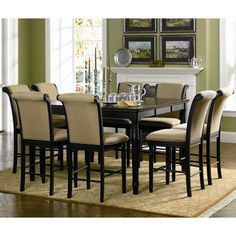 This is the Cabrillo Collection. The smooth table top has rounded corners and a beaded edge for a classic look, and features a convenient leaf so the length can be extended from 42 to 60 inches. Turned tapered legs are fresh but timeless, giving this table a transitional style that will blend nicely into any home. The matching counter height chairs have softly rolled backs and plush seats, covered in a rich textural golden tone fabric that will blend beautifully with your home decor. The…