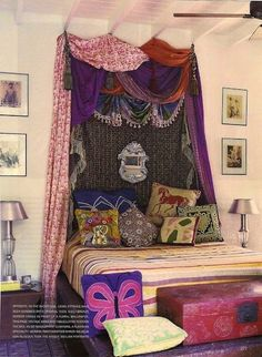 drapes/scarves over bed can make for an inexpensive headboard with a very dramatic effect!.
