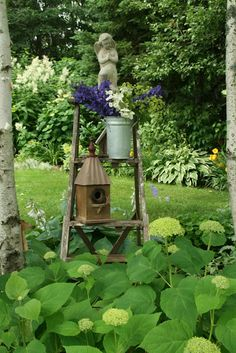 Old wooden ladder and garden angel