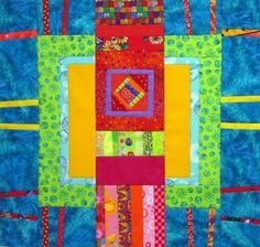 Two of six completed large quilt blocks, each a piece of art on its own.