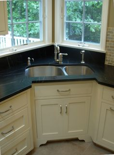 beautiful corner sink with soapstone counters