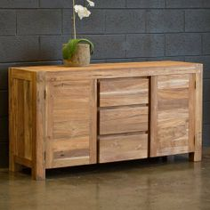 Reclaimed Teak Simple Buffet by CG Sparks. $925.24. Sandblasted textured finish. Natural teak color. Made from Solid Reclaimed Teak. o1285060009 Features: -A simple clear coat is applied to seal the wood, and enhances the natural tone of the teak.-Materials: Reclaimed teak salvaged from the timbers of old buildings.-Sandblasted and sanded smooth to make a luxurious, smooth feel while maintaining its history.-Old nail holes and other details filled in with wood plugs.-S...