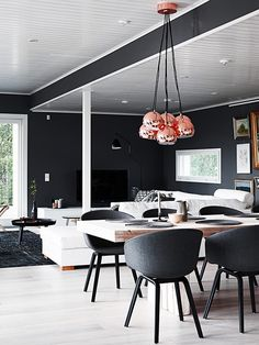 The Copper light fixture is amazing Eclectic finnish home with black walls. Photo by Krista Keltanen Alvar Aalto, Dining Area, Kitchen Dining, Dining Table, Hay Chair, Dark Walls, House And Home Magazine, Sweet Home, Interior Design
