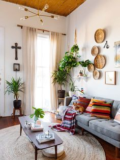 Den - I like the feeling of this room, the high ceilings, lights painted walls, plants and braided area rug ↠ ♧ maxxxcosmo ♧ ↞