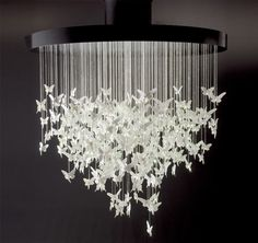 Not sure about you guys, but with a hefty price tag of around $90,000, this Lladro Niagara Chandelier is out, WAY OUT of my price range. But seriously, how hard would this be to make? I mean not exactly like this, not with porcelain or anything, but with paper butterflies and wire?