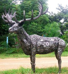 Custom sculpture made from Recycled Metal (recycled car& motorcycle parts) by Tom Samui