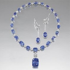 The necklace designed as a line of graduated cushion-shaped sapphires interspersed with brilliant-cut diamond clusters, decorated at the front with a detachable pendant of similar design; the pendent earrings each composed of a foliate surmount set with marquise-shaped and brilliant-cut diamonds, suspending a detachable pendant set with an oval sapphire, brilliant-cut and baguette diamonds, necklace length approximately 420mm.
