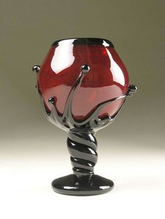 Black and red wine glass