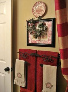 my french country guest bath, bathroom ideas, design d cor, Another French print with a toile mat a plate and a Christmas wreath top one of my favorites a thrift store towel bar from the now defunct Southern Living at Home