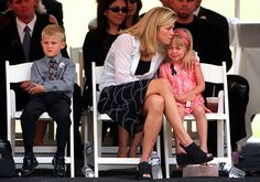 JUNE 26 2002- Flynn Kile comforts her daughter Sierra,5,  as her Kannon  during a public memorial for her husband and their father St. Louis Cardinal pitcher Darryl Kile Wednesday at Busch Stadium.