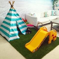 Play area in living room. Love the seaside wall mural