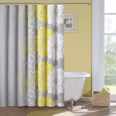 Add contemporary style to your bathroom with this floral showercurtain from Madison Park, which features cheery white and yellowflowers against a muted gray bac