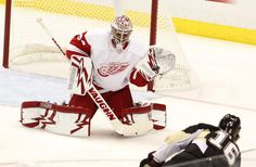 CrowdCam Hot Shot: Detroit Red Wings goalie Petr Mrazek makes a save against Pittsburgh Penguins center Brandon Sutter during the third period at the CONSOL Energy Center. The Detroit Red Wings won 4-1. Photo by Charles LeClaire