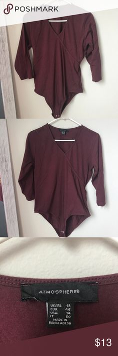 Like new quarter sleeve Leotard Maybe worn once. Great condition. Cotton quarter sleeve leatard. Burgundy color v neck top. Fitted. Atmosphere Tops