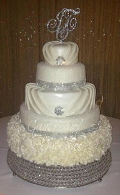 """""""Pure Glam"""" wedding Cake   ~ all edible. Love the middle layer, could do without the rest"""