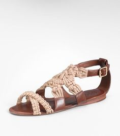 For weekends, or just walking, the Fleur Flat Sandal puts a new seaside twist on traditonal crochet with deck-inspired rope detailing. Exude a relaxed bohemian vibe in the texture-mixed pairing of craftsy macrame and gold-buckled leather for a look that transitions straight from beach to street.