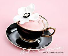 Black teacup. Pink cupcake.