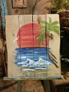 Sunset and palm trees on the ocean art by Stacie Sheets