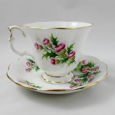 Beautiful bone china tea cup from Royal Albert. Cup and saucer have thistles and a castle scene. Pattern is Road to the Isles part of the Ancestral Series. Gold trimming on cup and saucer edges. Excellent condition (see photos). The markings read: Royal Albert Bone China England