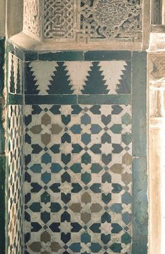 Image SPA 1005 featuring decorated area from the Alhambra, in Granada, Spain, showing Geometric Pattern using ceramic tiles, mosaic or pottery and stucco or plasterwork.