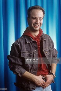 Italian singer-songwriter Marco Masini posing smiling for a photo session during the 41st Sanremo Music Festival. Sanremo, February 1991
