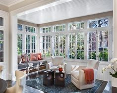 I like that we windows start at chair rail height with extra above the top. I like the dark floor and the functional window seat and cool ceiling. NICE!: