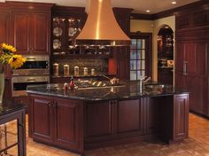 black granite counter tops with dark cabinets