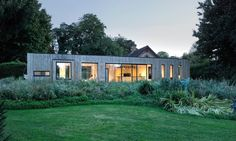 Adam Knibb Architects designed a beautiful and boxy prefabricated extension to a historic barn in England.