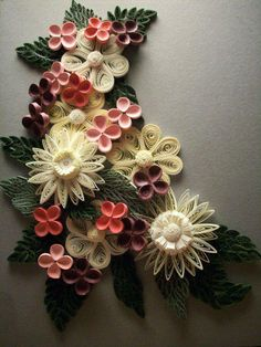 Quilling - Flowers I have a friend who quills. She is a paper genius. Just put out a book! Check her out here: http://paperzen.blogspot.ca/?m=1