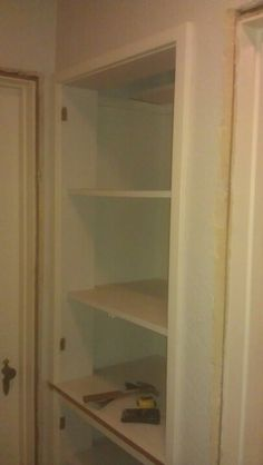 Hallway linen closet before remodel.