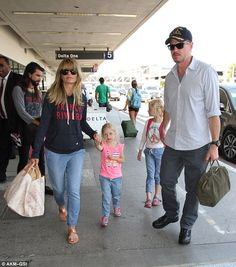 Safe travels: Eric Dane arrived to LAX on Tuesday with his wife Rebecca Gayheart and their...