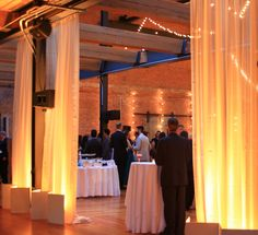 Fabric drapes with amber up-wash, installed by Get Lit, Special Event Lighting in Bay 7, American Tobacco Campus