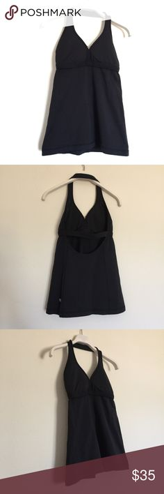 Lululemon black halter workout yoga tank 4 Lululemon black halter workout yoga tank, great condition. Removable pads. Halter style with keyhole open back. The very top Stitch in the center is split. Please see photo. lululemon athletica Tops