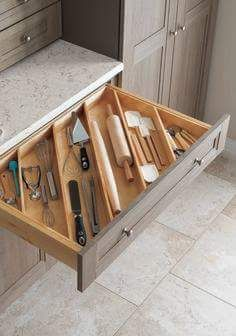 Put slats in drawer at an angle in order to fit long utensils